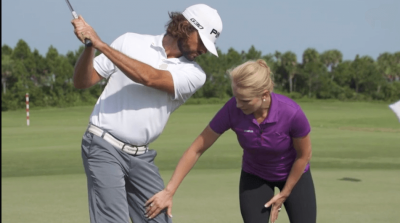 Barbara Depta working with golfer and swing